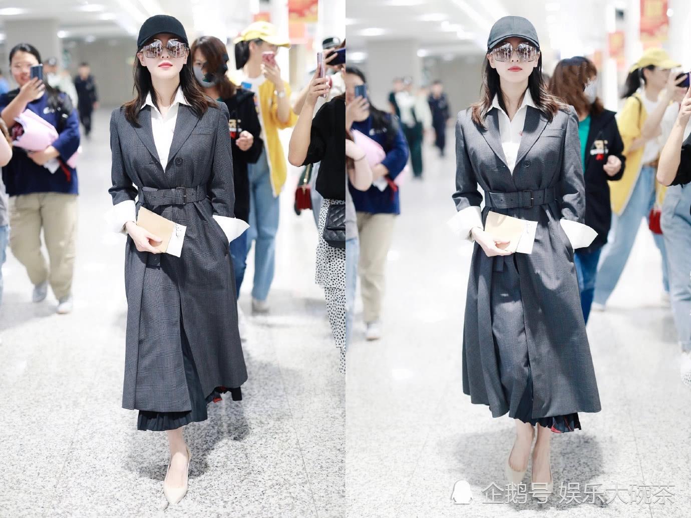 <b>刘诗诗气质真是太好了,身穿收腰风衣优雅又帅气,好身材太抢镜</b>